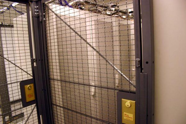 Data center cage with secured and locked servers