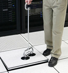 Man removing data center floor tile