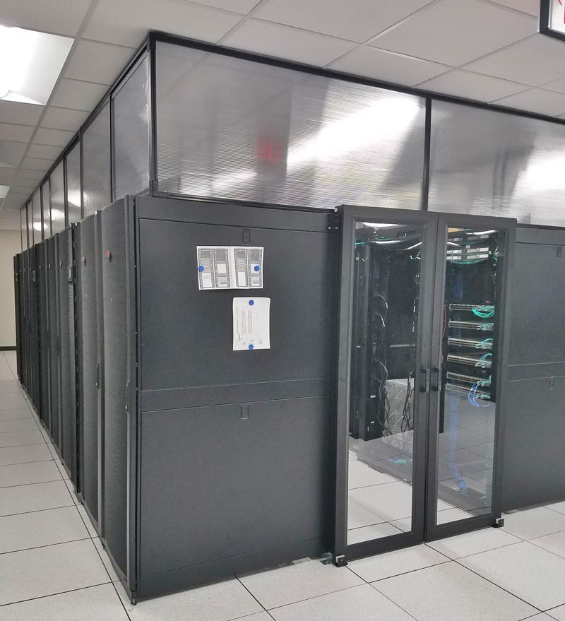 Data Center with double sliding doors, servers, raised floor and sub containment panels.