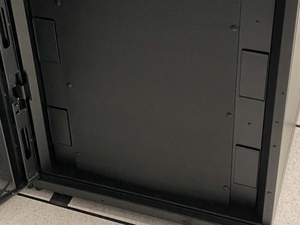 Black blanking panel with black clips on server rack