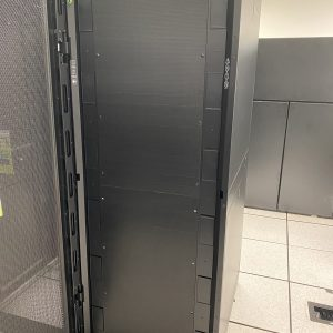 Black server with open door in a data center