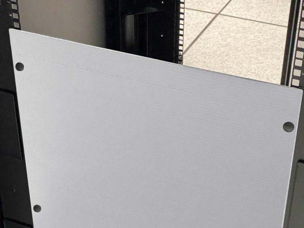 White blanking panel in server room on rack